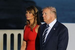 US President Donald Trump and US First Lady Melania Trump arrive for a family picture with G-7 leaders and guests, on the second day of the G7 summit in Biarritz, on Aug 25, 2019.