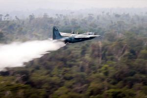 A Hercules C-130 plane of Brazil's Air Force dropping water to fight fires at the Amazon forest, on Aug 25, 2019.