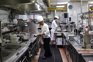 Non-slip mats being used in the main kitchen of the Regent Singapore hotel on Aug 26. Minister of State for Manpower and National Development Zaqy Mohamad commended the hotel for its safety practices during his speech at the Workplace Safety and Heal