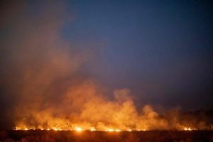 A fire burns out of control after spreading onto a farm along a highway in Nova Santa Helena municipality in northern Mato Grosso State, south in the Amazon basin in Brazil, on Aug 23, 2019.