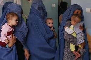 Mothers along with babies who suffer from malnutrition wait at a Unicef clinic in Jabal Saraj, north of Kabul, Afghanistan.