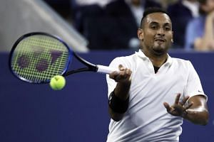 Nick Kyrgios returns to Steve Johnson on the second day of the US Open Tennis Championships at the USTA National Tennis Center in New York, on Aug 27, 2019.