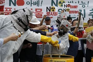 South Koreans dumping Japanese products at a rally in Seoul where they also demanded tracking of the country of origin of Japanese food additives.