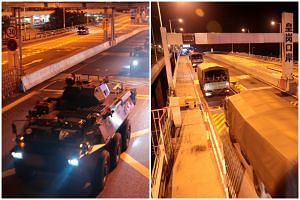Armoured personnel carriers and trucks of China's People's Liberation Army (PLA) pass through the Huanggang Port border between China and Hong Kong on Aug 29, 2019.