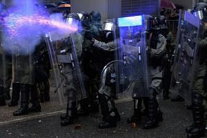 Police fire tear gas during a protest in Tsuen Wan district of Hong Kong on Aug 25, 2019.