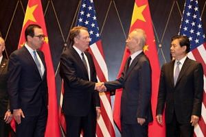In a photo taken on July 31, 2019, US Trade Representative Robert Lighthizer shakes hands with Chinese Vice-Premier Liu He at the Xijiao Conference Center in Shanghai.