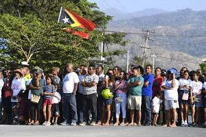 Locals watch as a bridge named after former Indonesian president Bacharuddin Jusuf Habibie is inaugurated in Dili, Timor-Leste, on Aug 29, 2019.