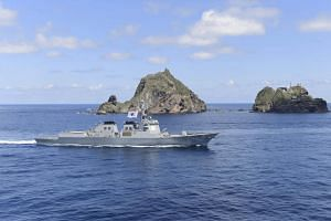 A South Korean naval ship patrols around remote islands called Dokdo in Korean and Takeshima in Japanese during a military exercise on Aug 25, 2019.