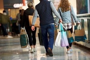 Shoppers at a mall in Pennsylvania, in the US. American retailers may do all they can to avoid raising prices during the back-to-school and holiday shopping season. But they will have no choice if tariffs continue to rise.