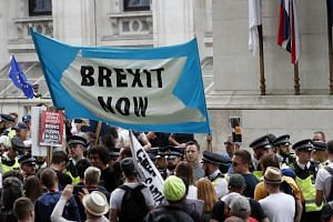In a photo from Aug 31, 2019, Brexit supporters gather during a rally in London.