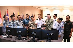Participants of the Asean-US Maritime Exercise using the Republic of Singapore Navy's Information Fusion Centre Real-time Information-sharing System at the Changi Command and Control Centre to sense-make information and identify vessels of interest