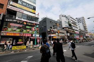 """The Shin-Okubo district in Tokyo, known as """"Little Seoul"""", lined with small shops selling Korean food and pop-culture items."""
