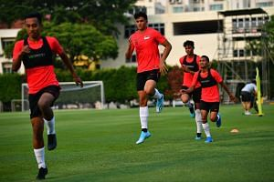Ikhsan Fandi (second from left) training with the Lions at Geylang Lorong 12 field on Sept 3, 2019.
