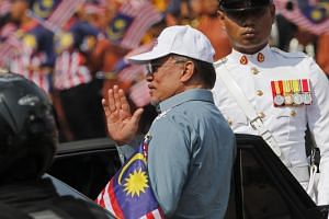 Malaysian politician Anwar Ibrahim waves at crowds during Independence Day celebrations in Putrajaya, Malaysia, on Aug 31 2019.