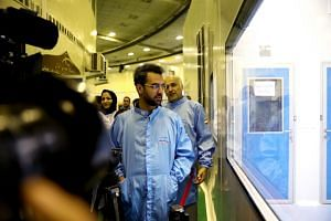 Iran's Minister of Information and Communications Technology Mohammad Javad Azari Jahromi visits the space research centre in Teheran.