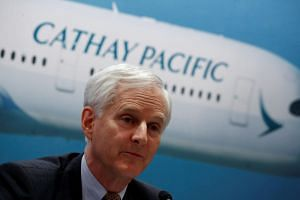 Cathay Pacific chairman John Slosar's (above) resignation follows the departure of chief executive Rupert Hogg last month.