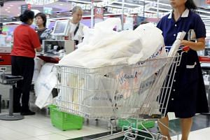 NTUC FairPrice will start charging 10 cents and 20 cents for plastic bag use at seven outlets in a month-long trial, starting from Sept 16.