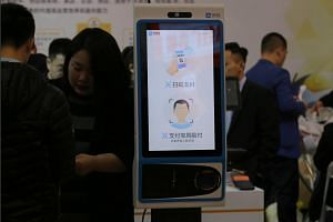 A machine with Alipay's facial recognition payment system is displayed at a smart business fair in Nanjing, Jiangsu province, China on March 21, 2019.