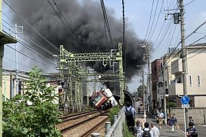 The first car of the train was seen to be derailed and on its side, with windows shattered and some parts of the train apparently charred.