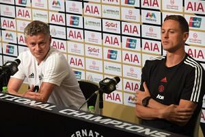 A photo taken on July 19 shows Manchester United's manager Ole Gunnar Solskjaer (left) and midfielder Nemanja Matic at a press conference in Singapore.