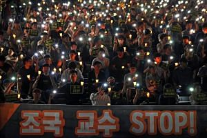 Students and graduates hold a rally at Pusan National University demanding an investigation into Justice Minister nominee Cho Kuk, in Busan, South Korea, on Aug 28, 2019.