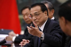 "Chinese Premier Li Keqiang said the Chinese government unswervingly safeguards the ""one country, two systems"" policy and the idea that ""Hong Kong people govern Hong Kong people""."