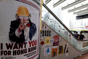 Posters and sticker notes supporting the anti-government protest movement are seen near the Central Government Offices in Hong Kong, on Sept 5, 2019.