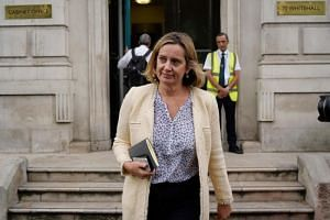 In a photo taken on Sept 3, 2019, British Work and Pensions Secretary and Women's minister Amber Rudd leaves the Cabinet Office on Whitehall in central London.