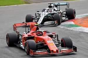Ferrari's Charles Leclerc (front) ahead of Mercedes' Lewis Hamilton during the Italian Grand Prix at the Autodromo Nazionale circuit in Monza on Sept 8, 2019.