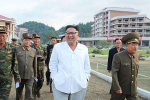 An undated photo from North Korea's Korean Central News Agency showing leader Kim Jong Un inspecting a construction site in Yangdok county. North Korean officials have criticised the US' position that sanctions against Pyongyang will not be lifted un