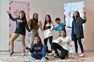Stylo Mylo Crew and dancer Vivien Tan (centre), recipients of The Business Times' Budding Artist Fund.