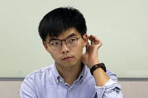 "Hong Kong democracy activist Joshua Wong was accused of ""inciting others to take part in unauthorised assembly"" among other charges and later released on bail."