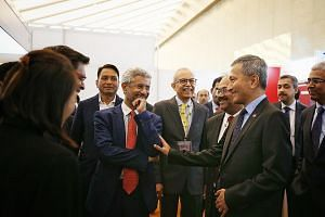 Foreign Minister Vivian Balakrishnan chatting with his Indian counterpart Subrahmanyam Jaishankar (in red tie) at the India Singapore Business and Innovation Summit yesterday. Singapore has been involved in the capital city project of Amaravati in An