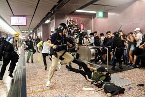 Police attempt to arrest protesters at Prince Edward MTR Station, Hong Kong, on Aug 31, 2019.