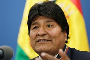 Critics link the fires to laws Bolivian President Evo Morales has passed encouraging farmers and ranchers to settle in forested areas in recent years.