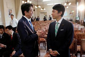 Japanese Prime Minister Shinzo Abe will reportedly name telegenic Shinjiro Koizumi as environmental minister.