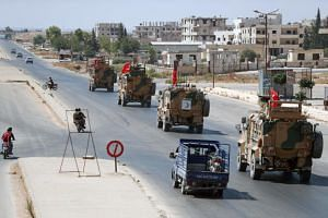 A photo taken on Sept 4 shows Turkish military vehicles patrolling near the Syrian town of Saraqeb, in the north-western province of Idlib.