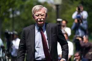 Bolton departs after speaking to the media about the uprising in Venezuela outside the West Wing of the White House in April 2019.