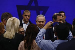 Netanyahu (centre) leaves after speaking during an event in Tel Aviv, Israel, on Sept 10, 2019.
