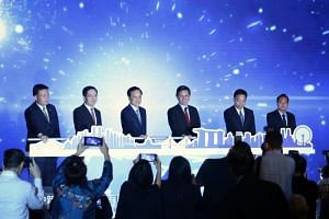 Singapore's Minister for Trade and Industry Chan Chun Sing (third from right) and Chongqing Party Secretary Chen Min'er (third from left) at the launch of the China-Singapore (Chongqing) International Data Channel, at the Singapore-China (Chongqing