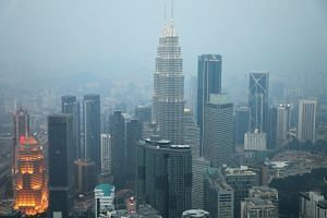A view of the city skyline shrouded by haze in Kuala Lumpur on Sept 11.