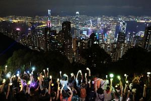 Protesters form a human chain on top of the iconic Lion Rock in Hong Kong on Sept 13, 2019.