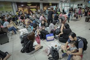 Stranded passengers at Sultan Azlan Shah Airport in Ipoh after flights were cancelled due to haze, on Sept 13, 2019.