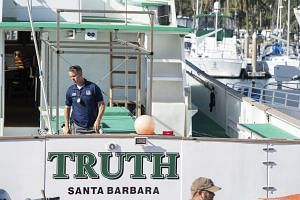 FBI agents search the Truth dive boat, a sister vessel to the Conception, on Sept 8, 2019.