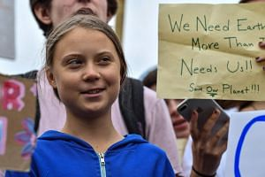 Greta Thunberg takes part in a climate protest outside the White House in Washington.