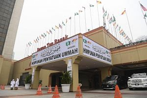 """The """"Himpunan Penyatuan Ummah"""" or """"Unity Gathering of the Muslim Faithful"""" organised by Umno and PAS kicked off in Kuala Lumpur yesterday with a series of town halls and rallies that claimed the Malays and their religion were being sidelined by the p"""