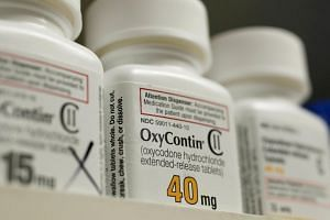 Bottles of prescription painkiller OxyContin made by Purdue Pharma on a shelf at a local pharmacy in Provo, Utah, on April 25, 2017.
