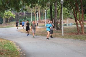 People jogging in Bishan-Ang Mo Kio Park at about 5.30pm on Sept 15, 2019.