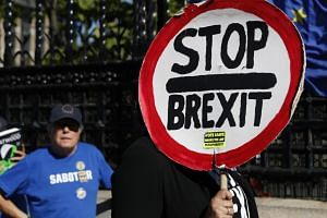 Anti-Brexit protesters demonstrate outside the Houses of Parliament in London, on Sept 12, 2019.