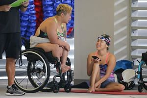 Theresa Goh (left) and Yip Pin Xiu chat with one another between races at the SPH Foundation National Inclusive Swimming Championships on May 5, 2019.